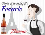 Láhev francouzského vína a miniatura krému k ošetření.
